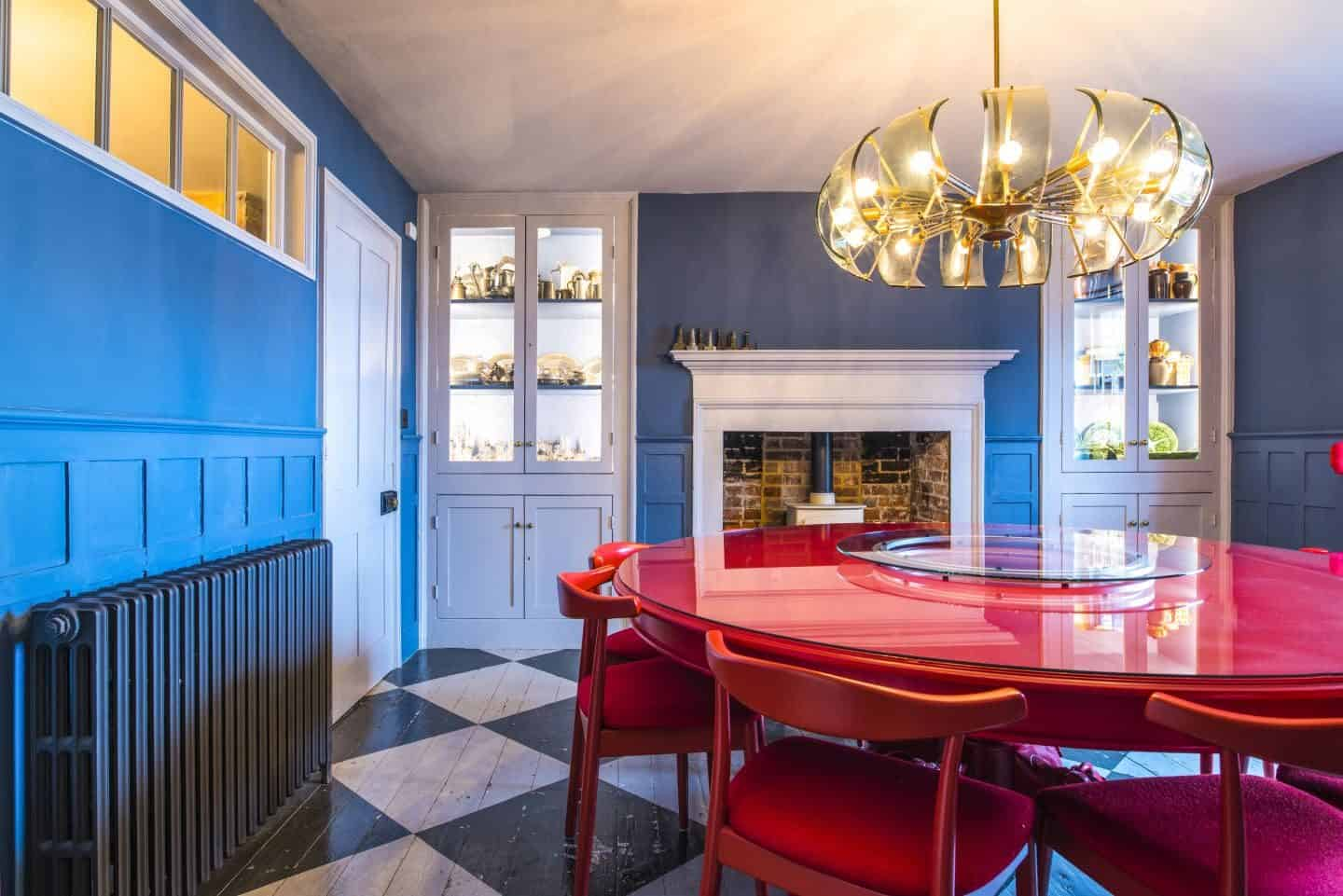 Image from the book Love Colour ©annastarmer - A blue dining room with red table and chairs