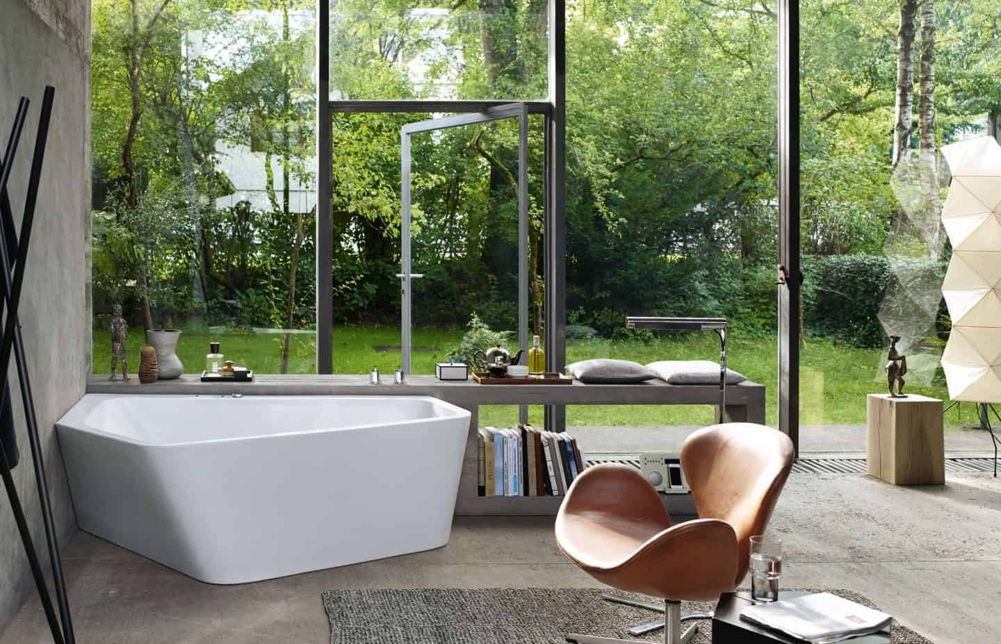 Luxury bathroom brand Duravit showcases the Paiova 5 bathtub in front of a large wall of glass