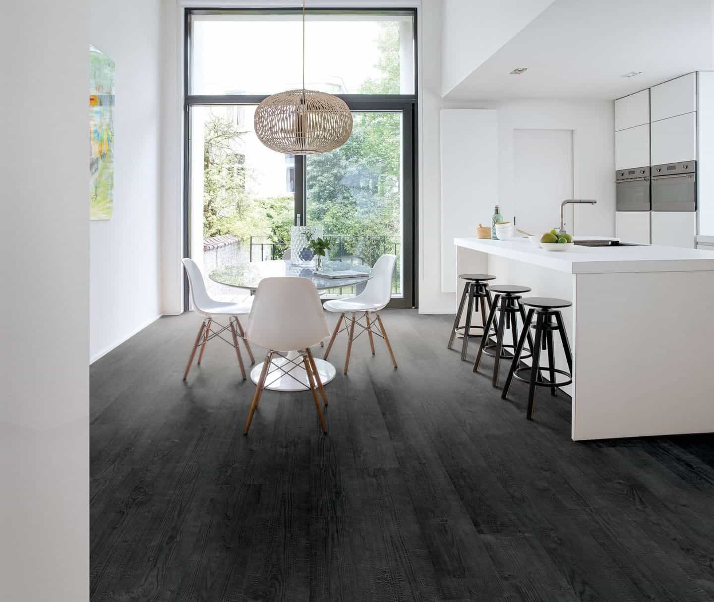 Flooring trends - quickstep flooring - black floor planks used in modern white kitchen