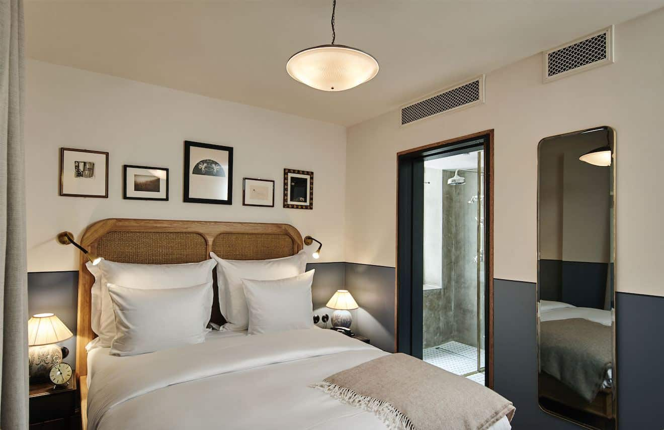 Sander Hotel, a design hotel in copenhagen. The beds have rattan headboards and crisp white linen.