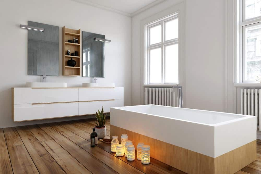 Radiator Buying Guide - Bathroom featuring cast iron radiators below the windows