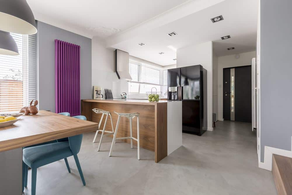 Radiator buying guide - modern kitchen diner featuring a vertical purple column radiator