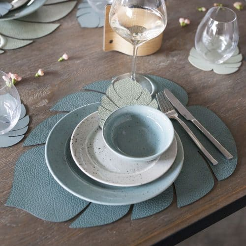 Monstera Leaf-shaped green recycled leather placemats by LIND DNA