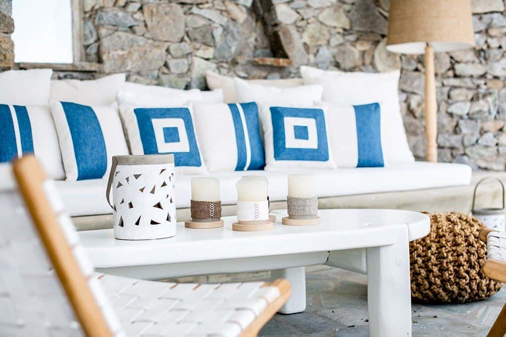 Interview with Dionas Sotiriou, co-founder of Maison Flaneur. Image of a seating area at a hotel in Greece