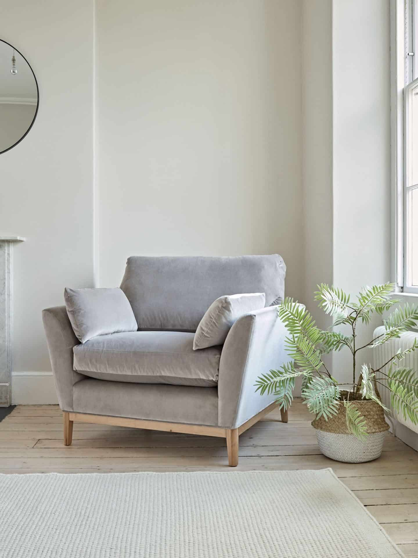 A grey armchair from Cox & Cox. Furniture can be found on furniture comparison website Kuldea