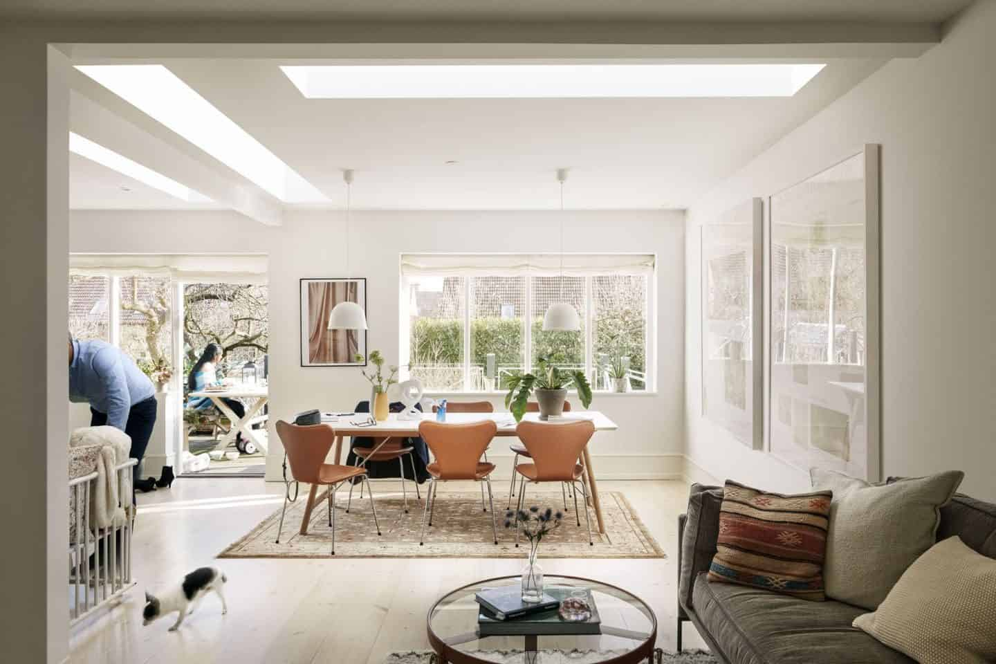 Vario by VELUX Bespoke Flat Roof Windows pictured above a dining room table and small seating area.