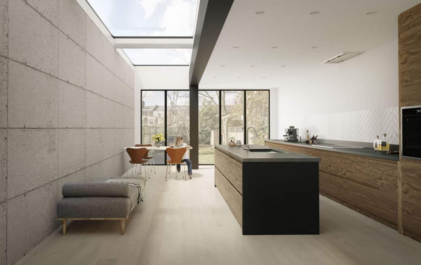 Vario by VELUX Bespoke Flat Roof Windowspictured above a modern open plan kitchen diner with raw concrete wall panels