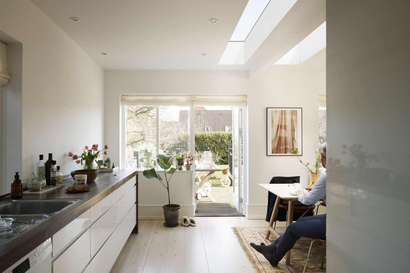 Vario by VELUX Bespoke Flat Roof Windows pictured above an open plan kitchen dining area