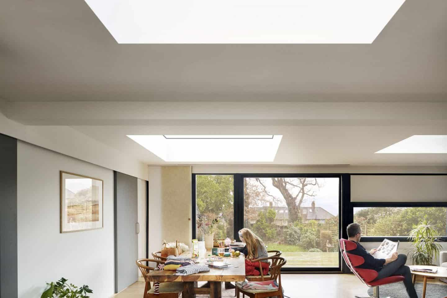 Vario by VELUX Bespoke Flat Roof Windows pictured above an open plan lounge diner