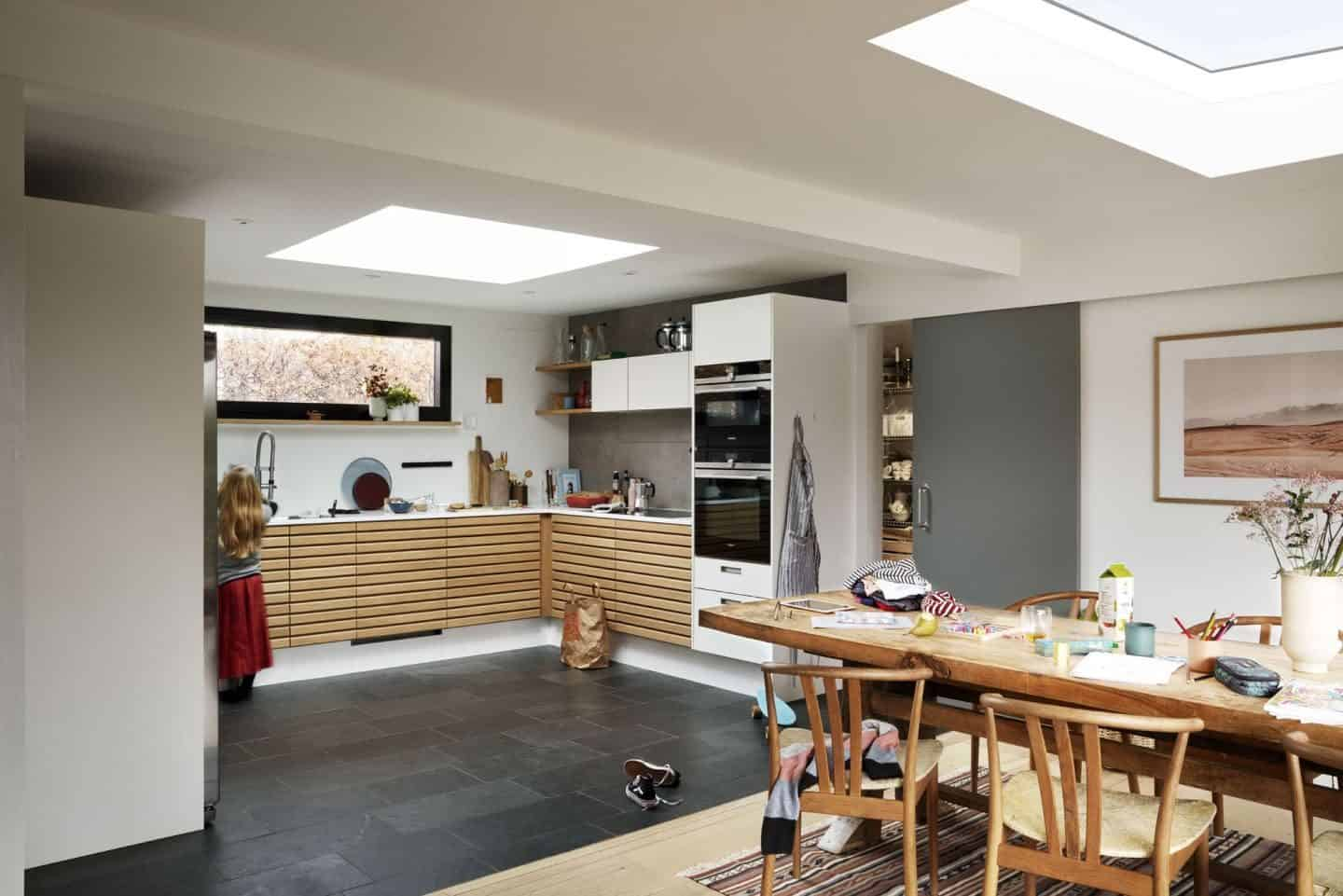 Vario by VELUX Bespoke Flat Roof Windows pictured above an open plan kitchen diner