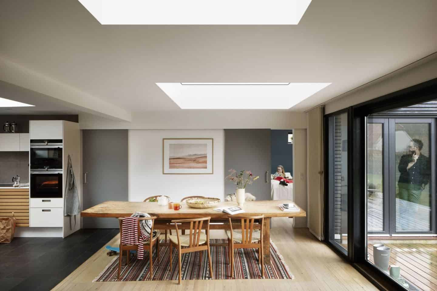 Vario by VELUX Bespoke Flat Roof Windows pictured above a large wooden dining table