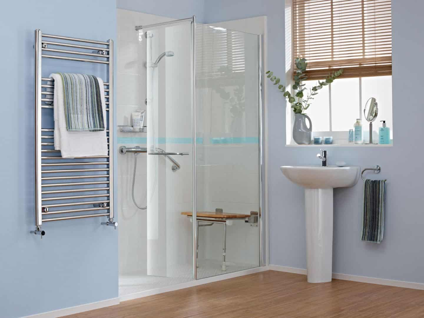 Accessible bathroom design from Premier Care Bathrooms. A walk-in shower feturing integrated shower seat and grab rails.
