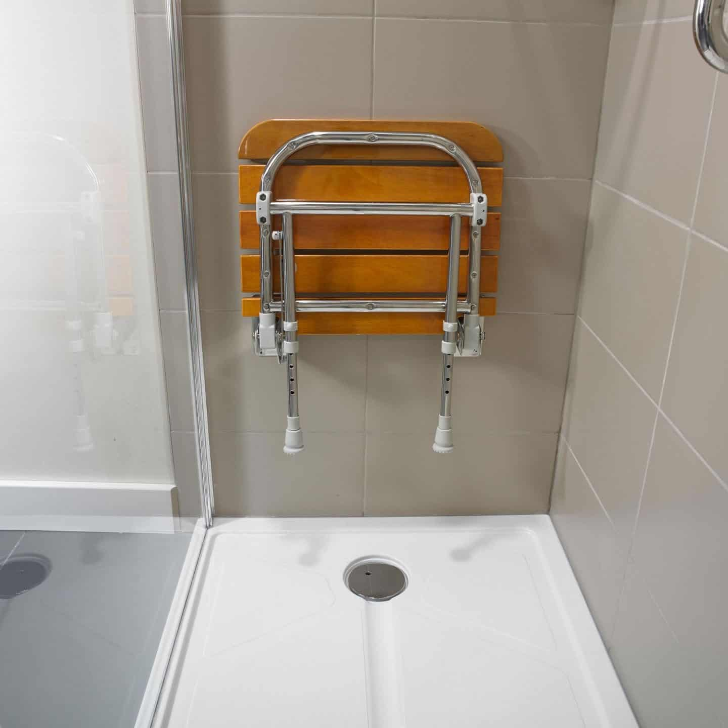 Accessible bathroom design from Premier Care Bathrooms. A shower seat is useful for people with balance or mobility issues.