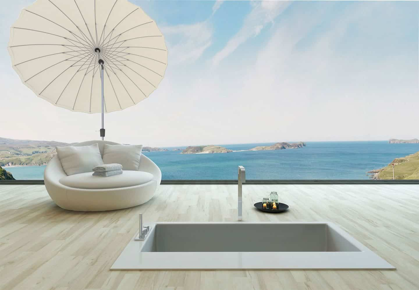 Garden Parasol from Solero Parasols. Large round white garden parasol angled above an outdoor loungen chair