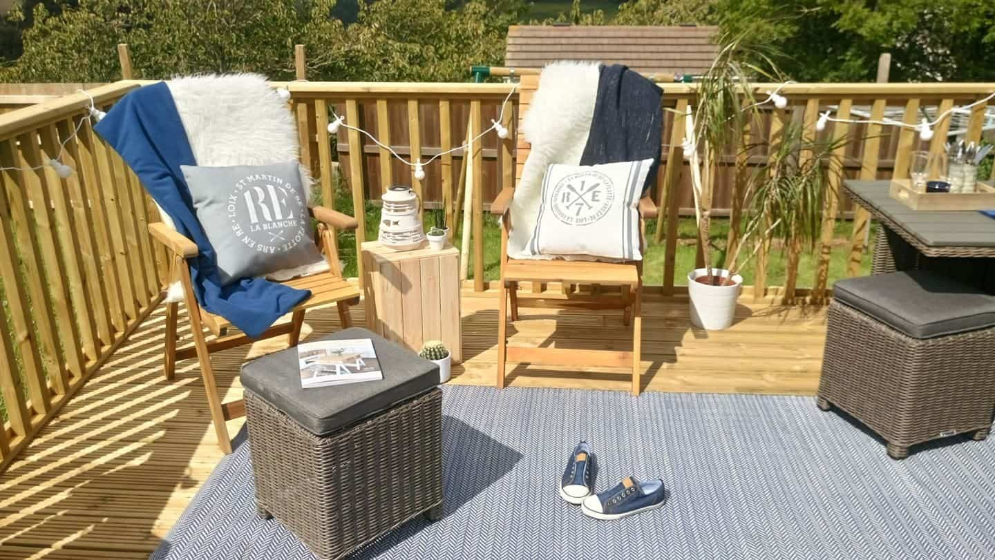 Garden decking set up for entertaining with a nautical theme.