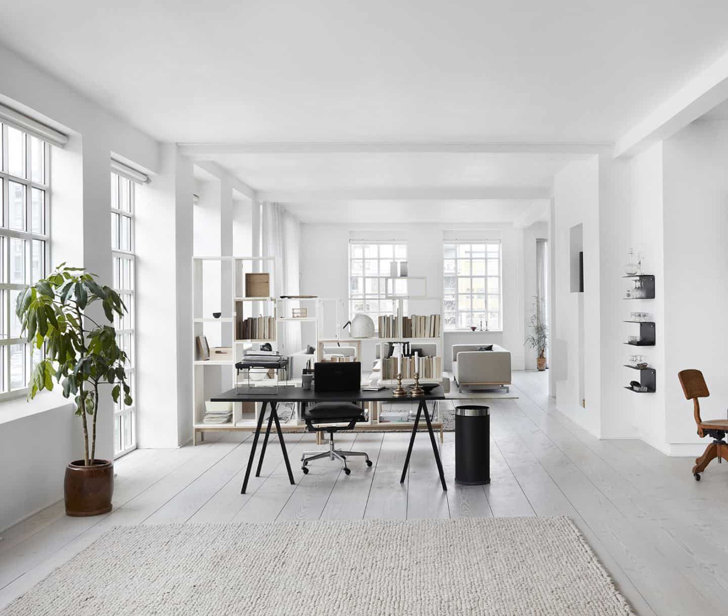 Open plan living room and office area in the converted factory home of Vipp owner Jette Egelund