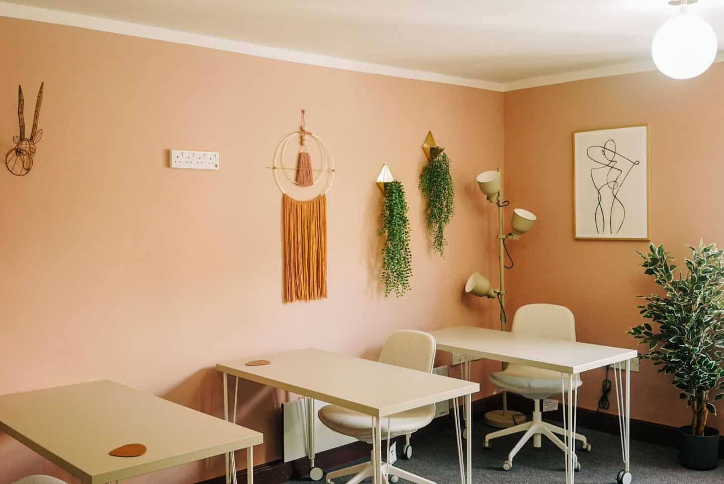 Three desks at The Tribe, a coworking space in Totnes for female entrepreneurs