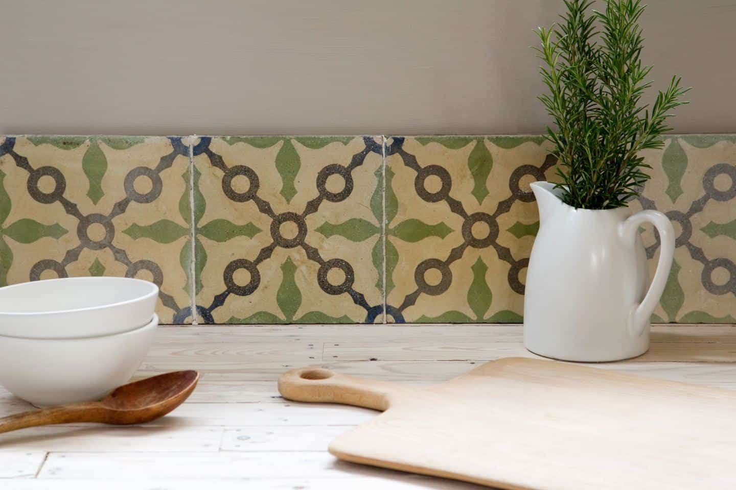Reclaimed or antique tiles used as a kitchen splashback -Maitland & Poate