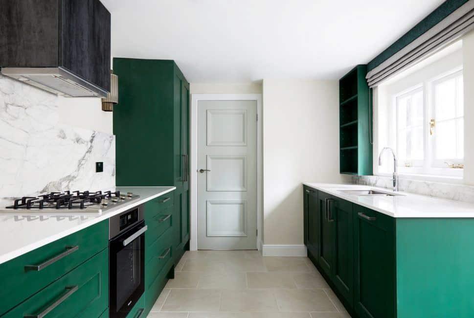 Kitchen design trends - green kitchen cabinet and marble backsplash. Design by Kia Designs