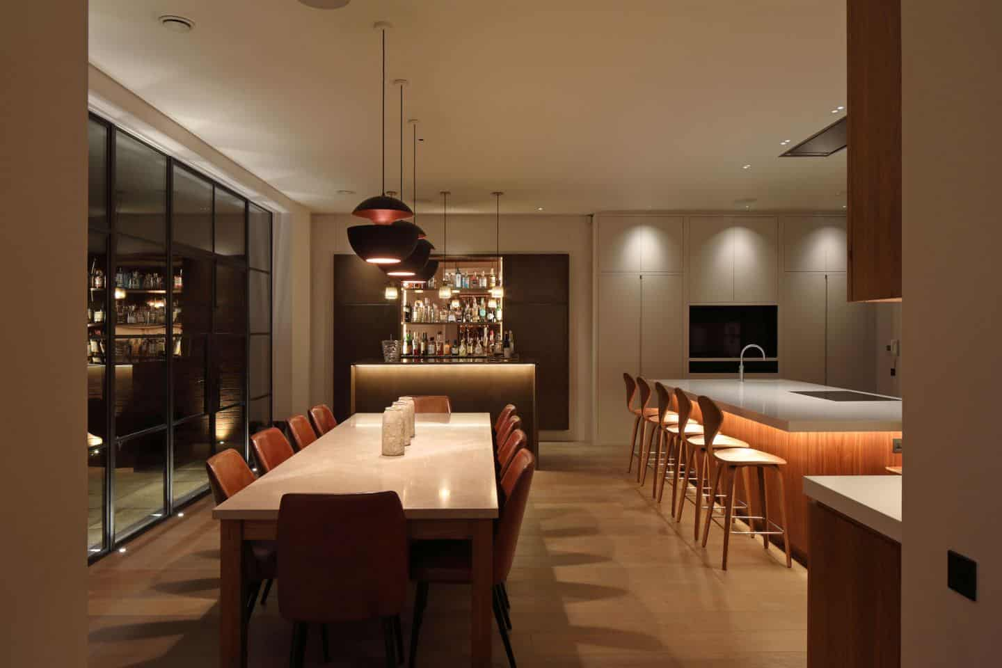 Kitchen design trends - Layered lighting in a kitchen/dining room. Lighting by John Cullen Lighting