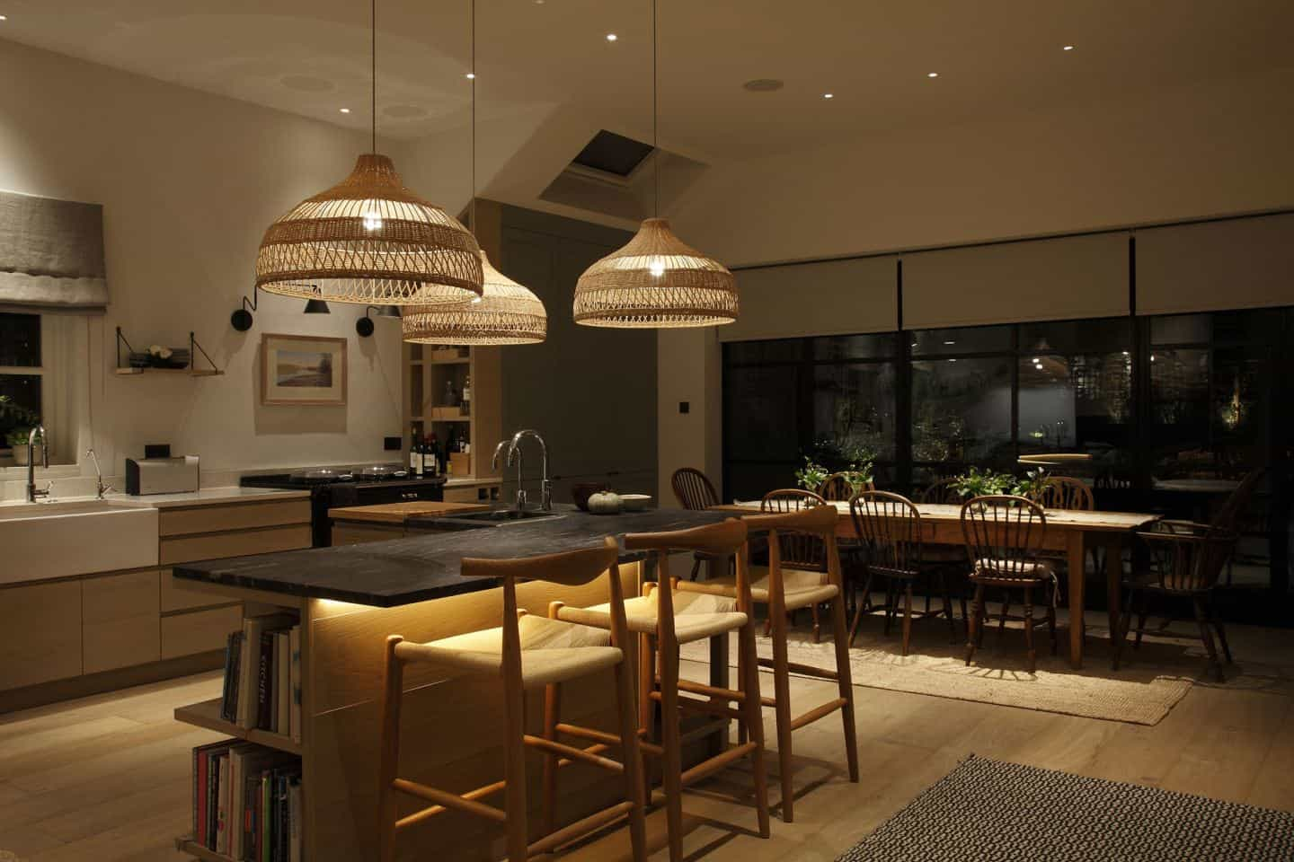 Kitchen design trends - Decorative lighting in a kitchen/dining room. Lighting by John Cullen Lighting