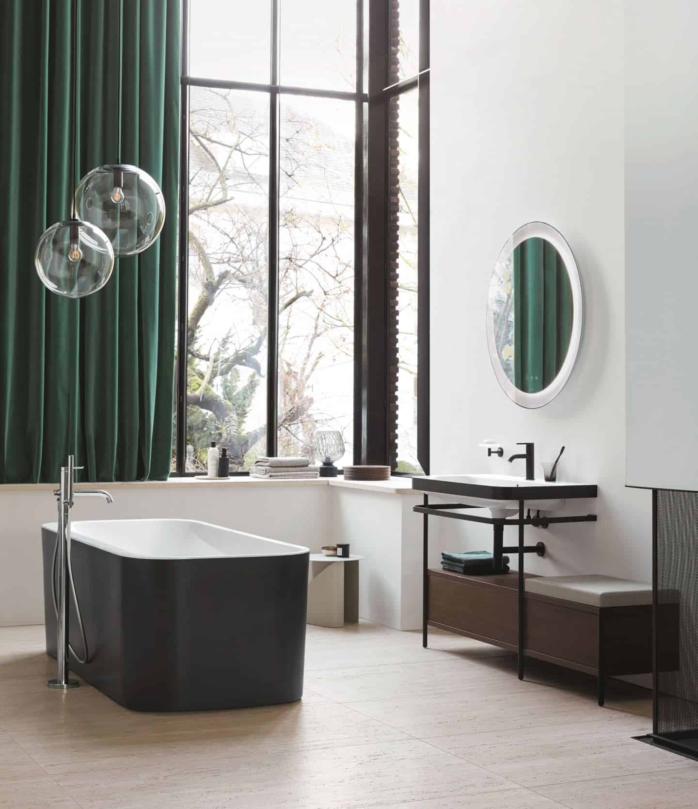 Duravit Happy D.2 Plus C-Shaped bathroom range. Free-standing bathtub with matt black exterior and sink console with a seat and extra storage.