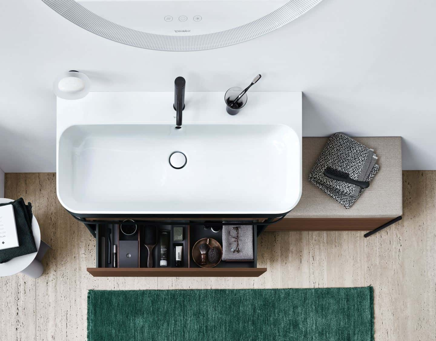 Duravit Happy D.2 Plus C-Shaped bathroom range. Sink console with a seat and extra storage.