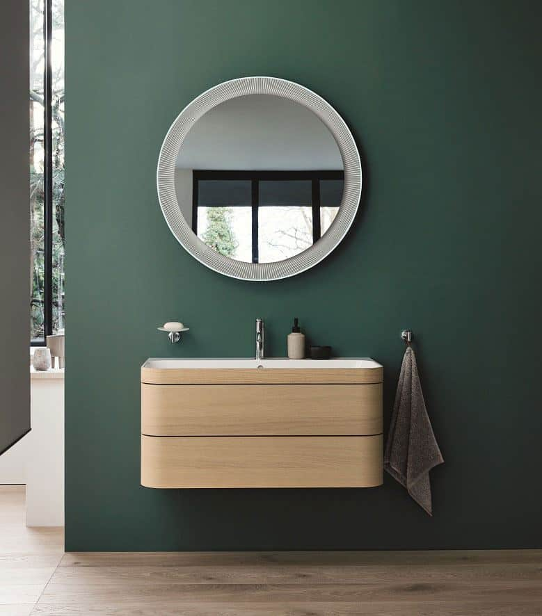 Duravit Happy D.2 Plus C-Shaped bathroom range. Wall-mounted vanity unit with two drawers and large circular mirror above.