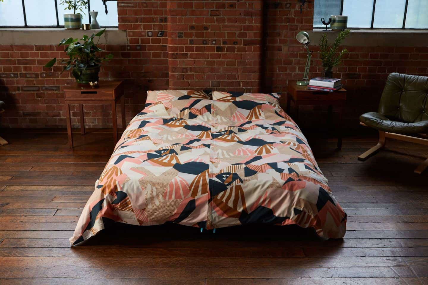 Koa revolutionary duvet cover shown in an industrial loft bedroom. The easy way to change a duvet cover