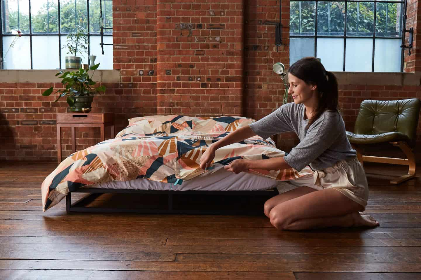Koa revolutionary duvet cover. A women zips up the base of the duvet cover. The easy way to change a duvet cover
