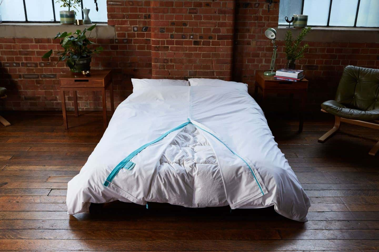 Koa revolutionary duvet cover shown in an industrial loft bedroom. The white duvet cover would be perfect for hotels. The easy way to change a duvet cover