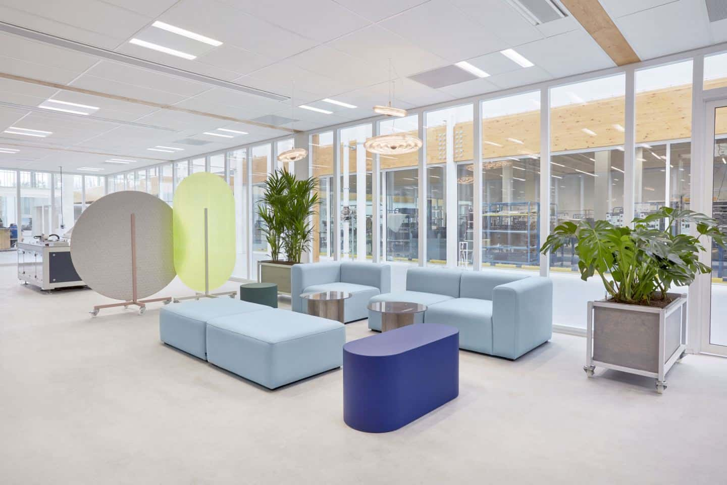 Protective Office Screens for the post-pandemic workplace by Dutch Invertuals used in a lobby seating area