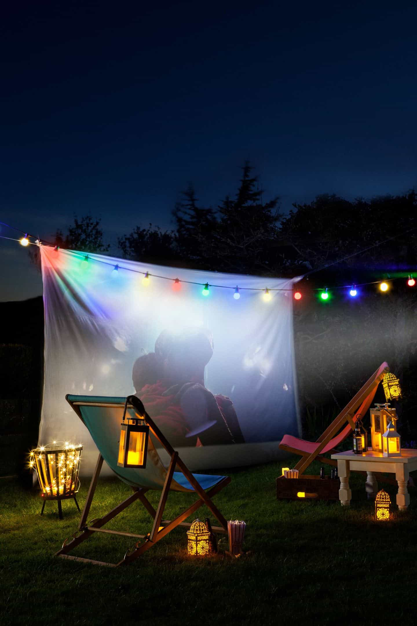 An outdoor movie screening in the perfect activity for your summer staycation in your garden