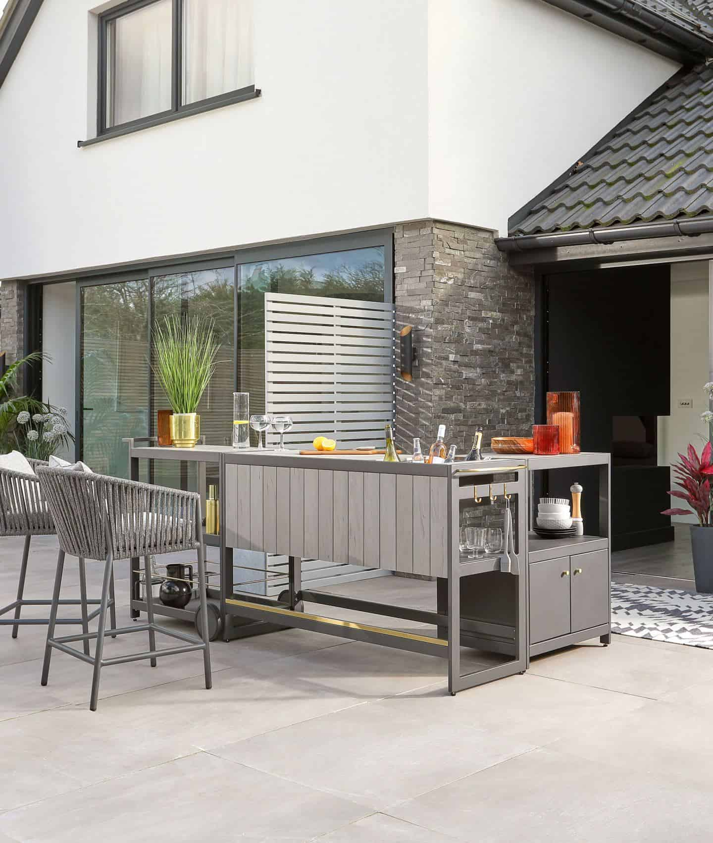 An outdoor kitchen bar makes entertaining much easier for your summer staycation in your garden