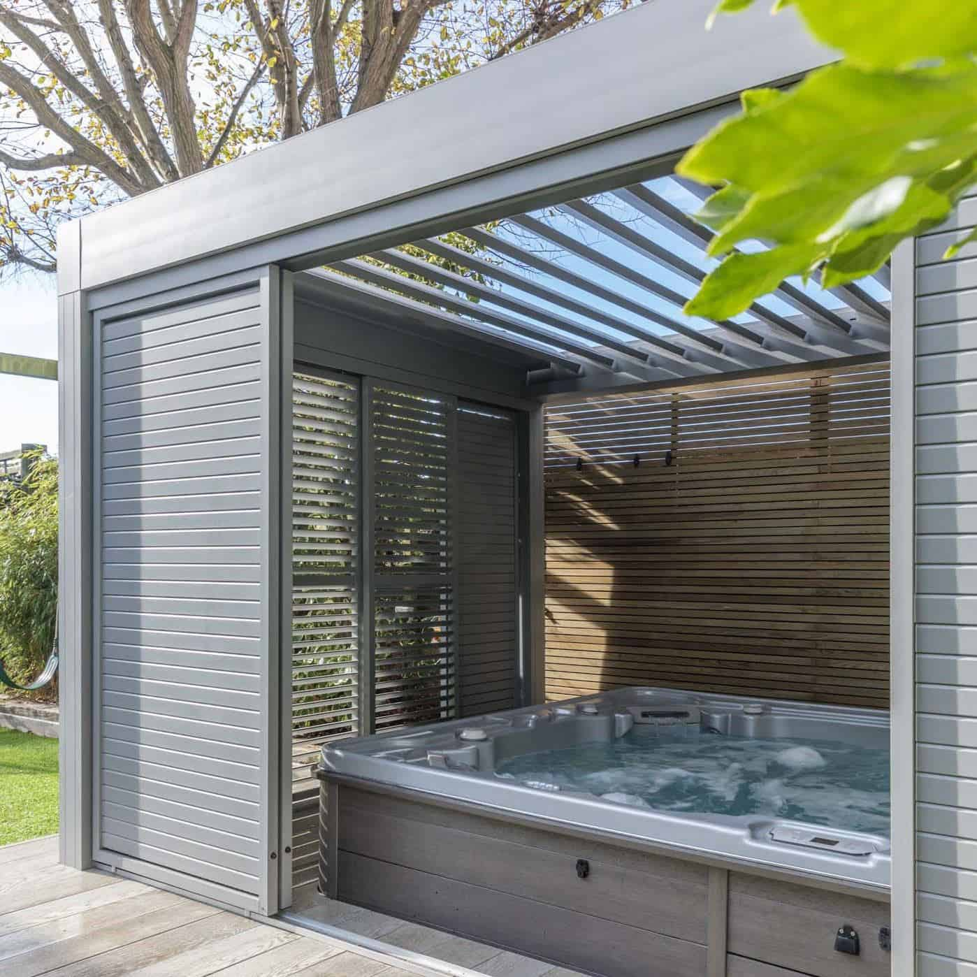 An undercover hot tub brings spa vibes to your summer staycation in your garden