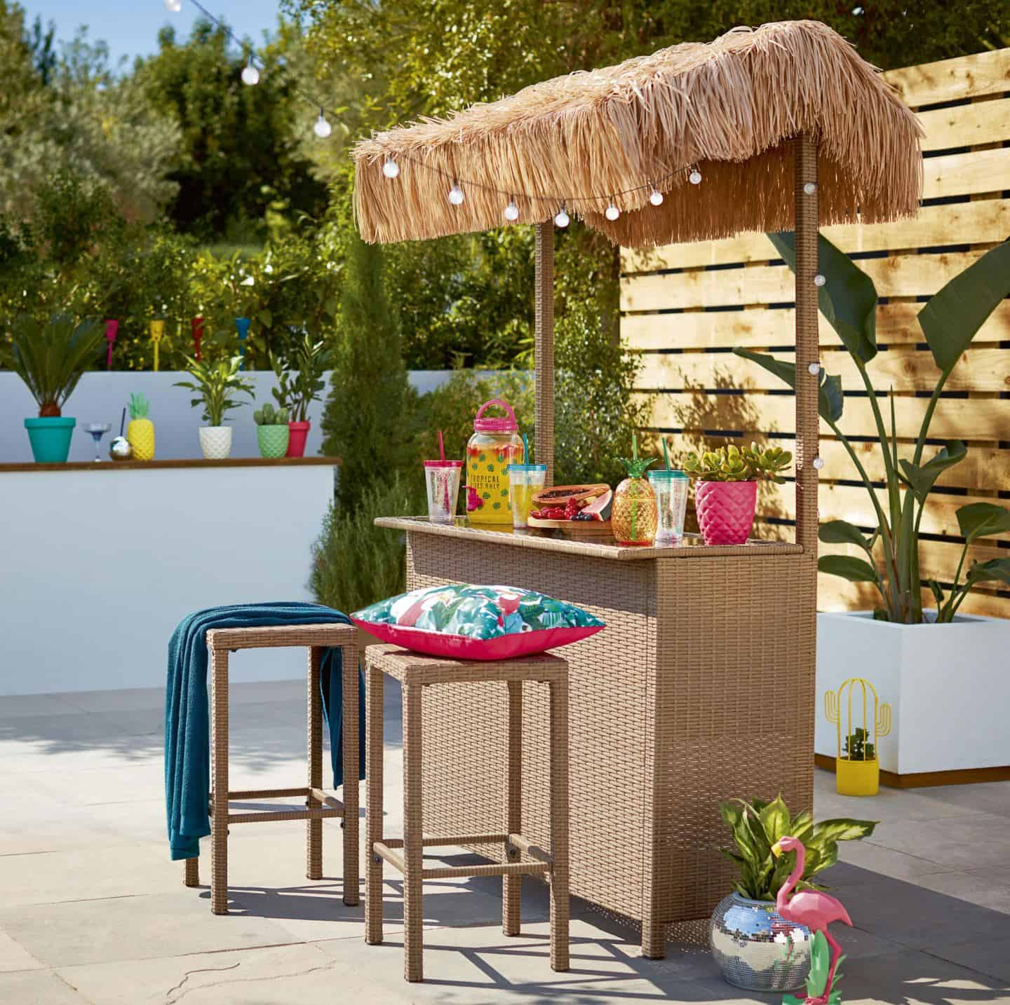 A tiki bar adds instant holiday vibes to your summer staycation in your garden