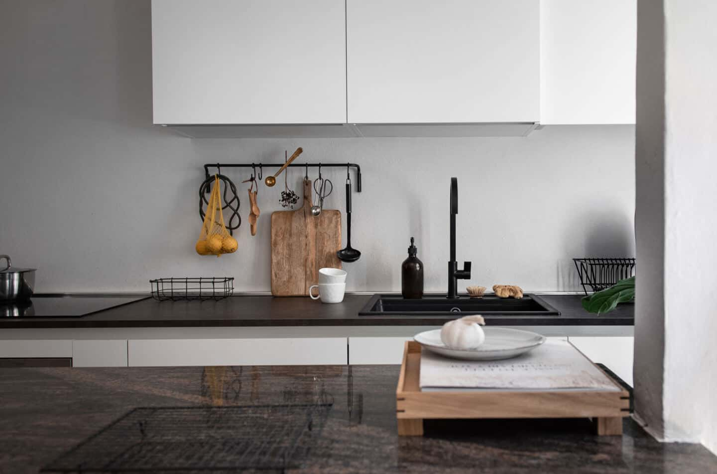 6 Easy Ways to Spruce Up Your Kitchen on a Budget - Image of a kitchen sink with cabinets above