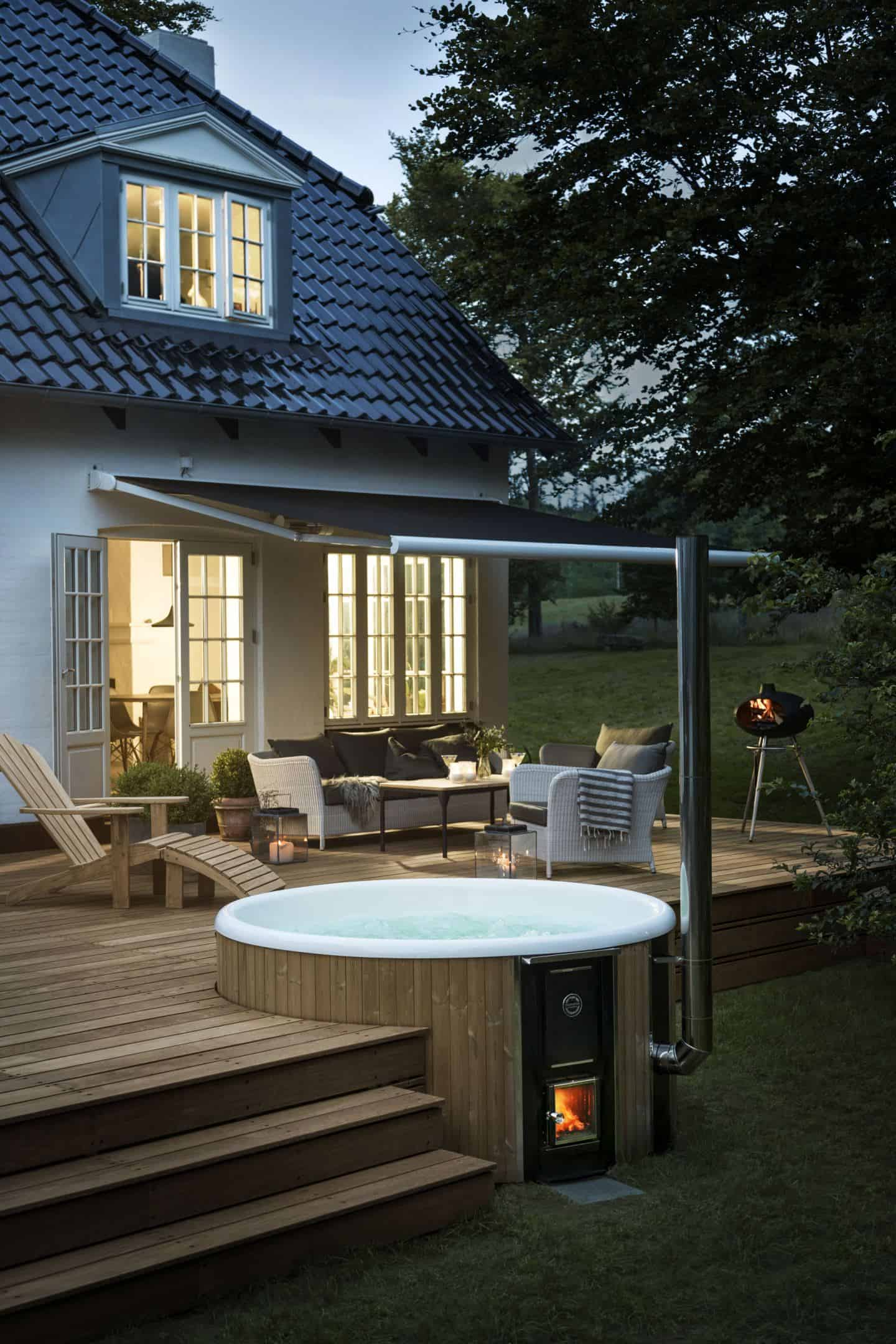 A luxurious wood-fired hot tub brings that holiday feeling to your summer staycation in your garden