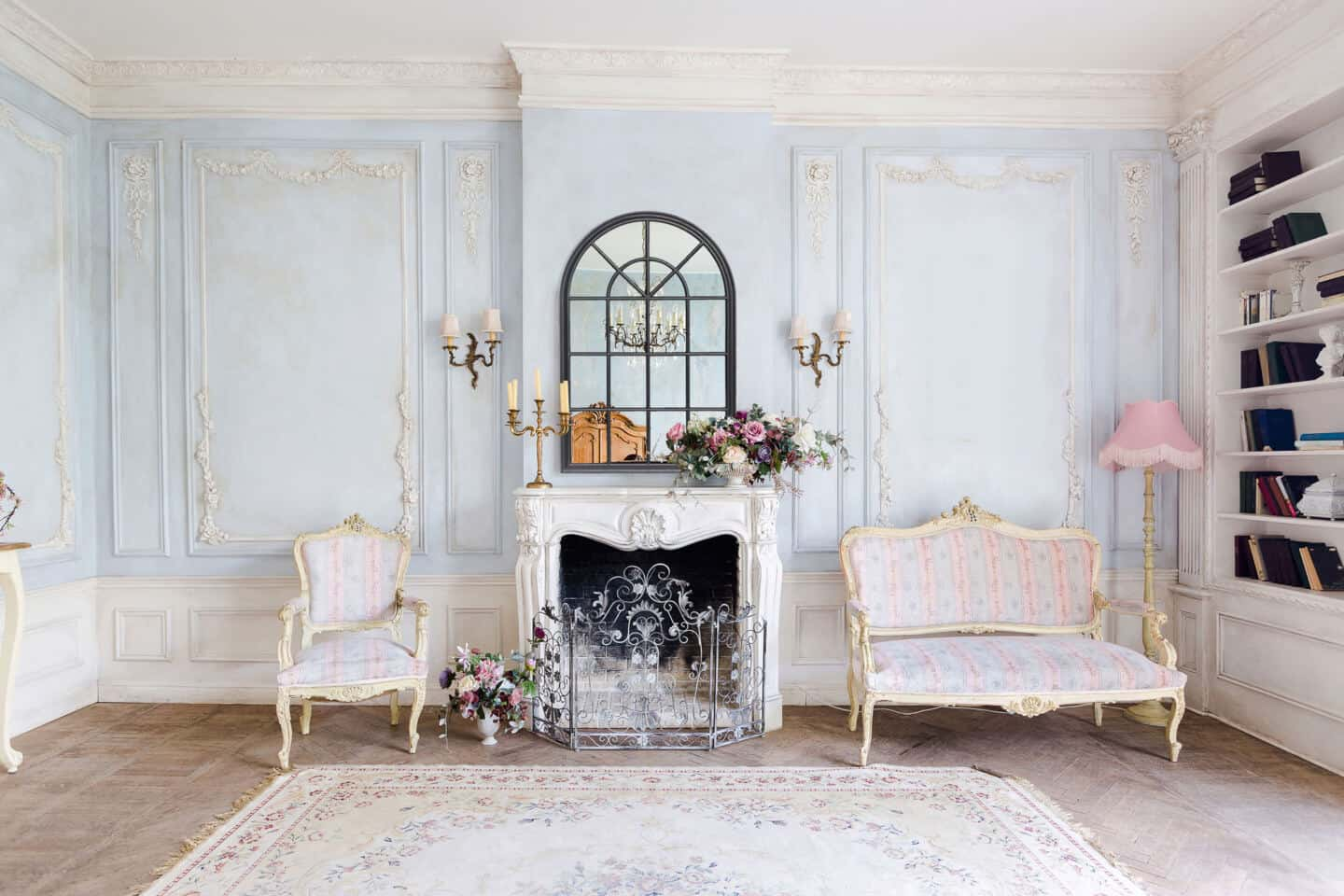8 ways to use mirrors in your interiors. Casa Chic Boutique window mirror in  black hung above the fireplace in a french chateau style interior.