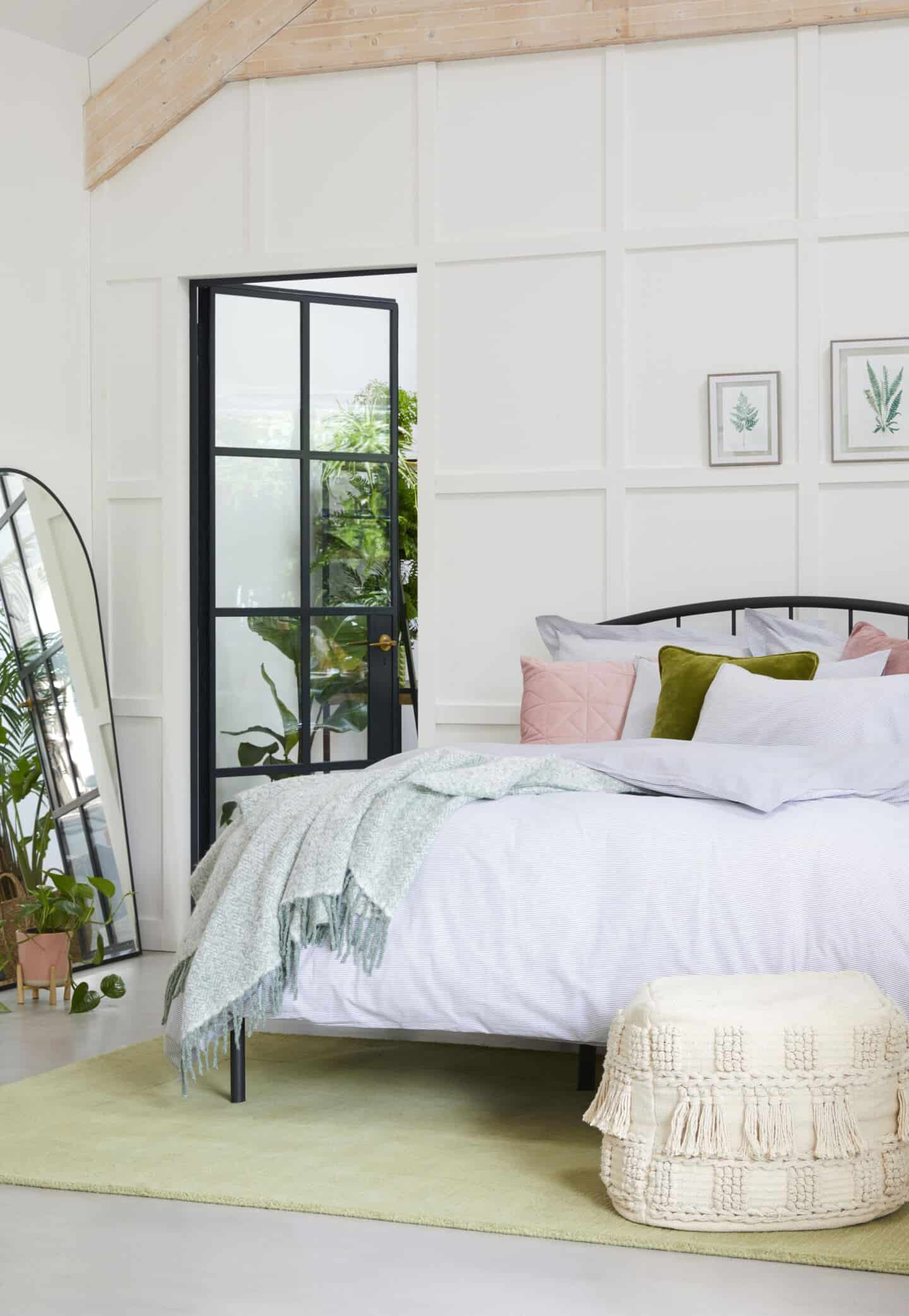 Sancturary is a SS20 interiors trend by Dunelm that features nature in interiors. This bedroom features lots of tactile textures, natural materials and plants.