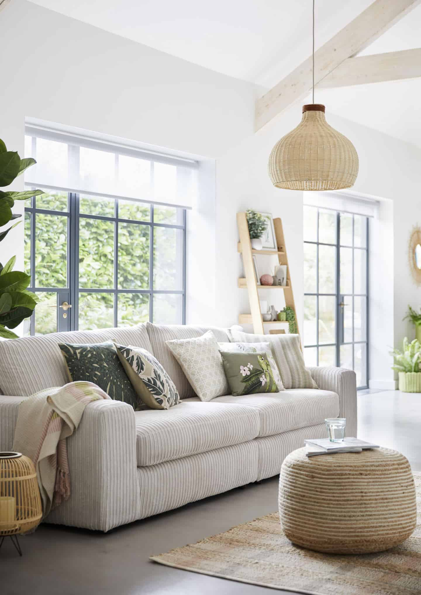 Sancturary is a SS20 interiors trend by Dunelm that features nature in interiors. This living room features lots of tactile textures, natural materials and leafy green prints.