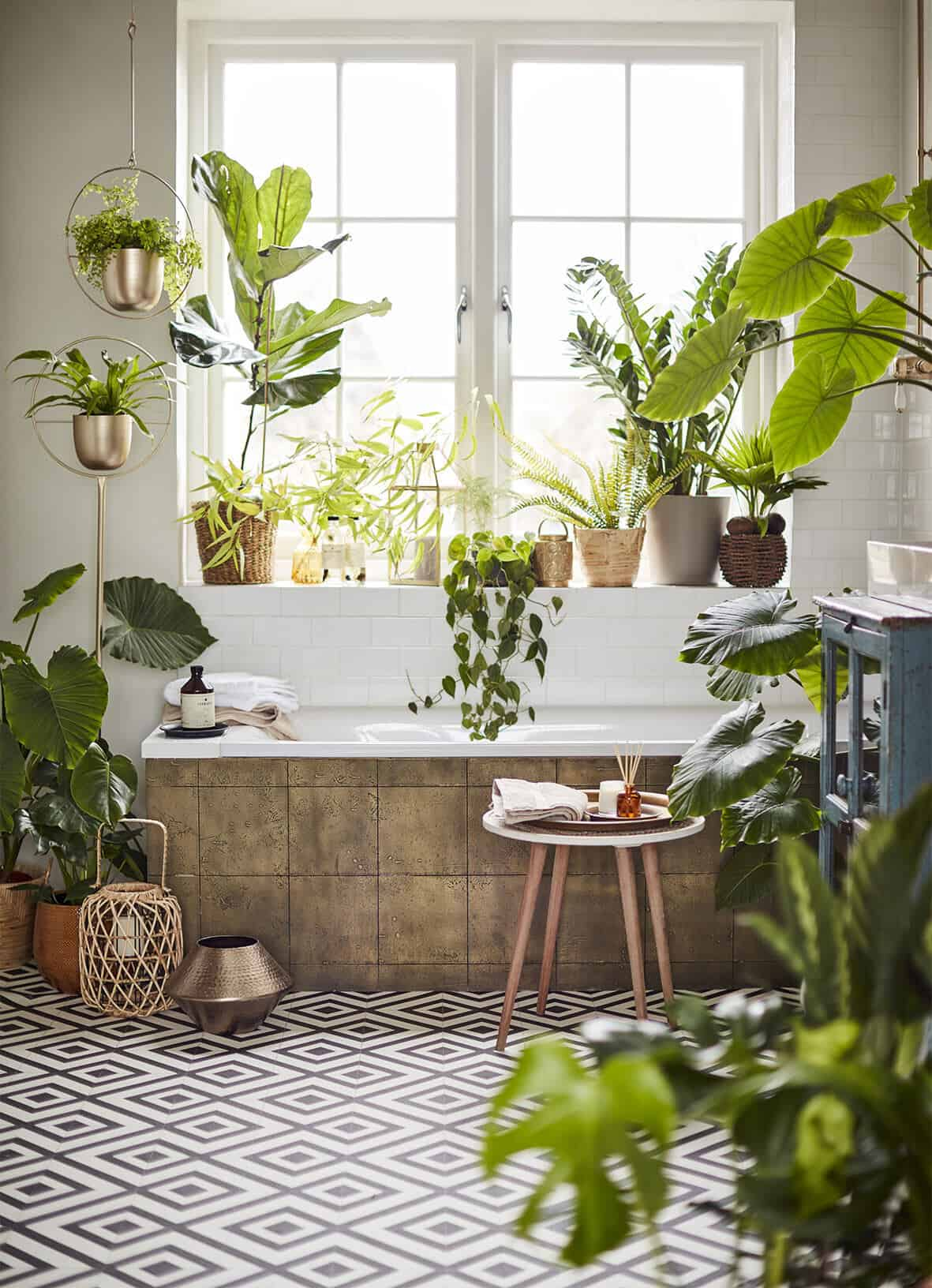 Bringing Natural Elements into the Home. A bathroom packed full of plants