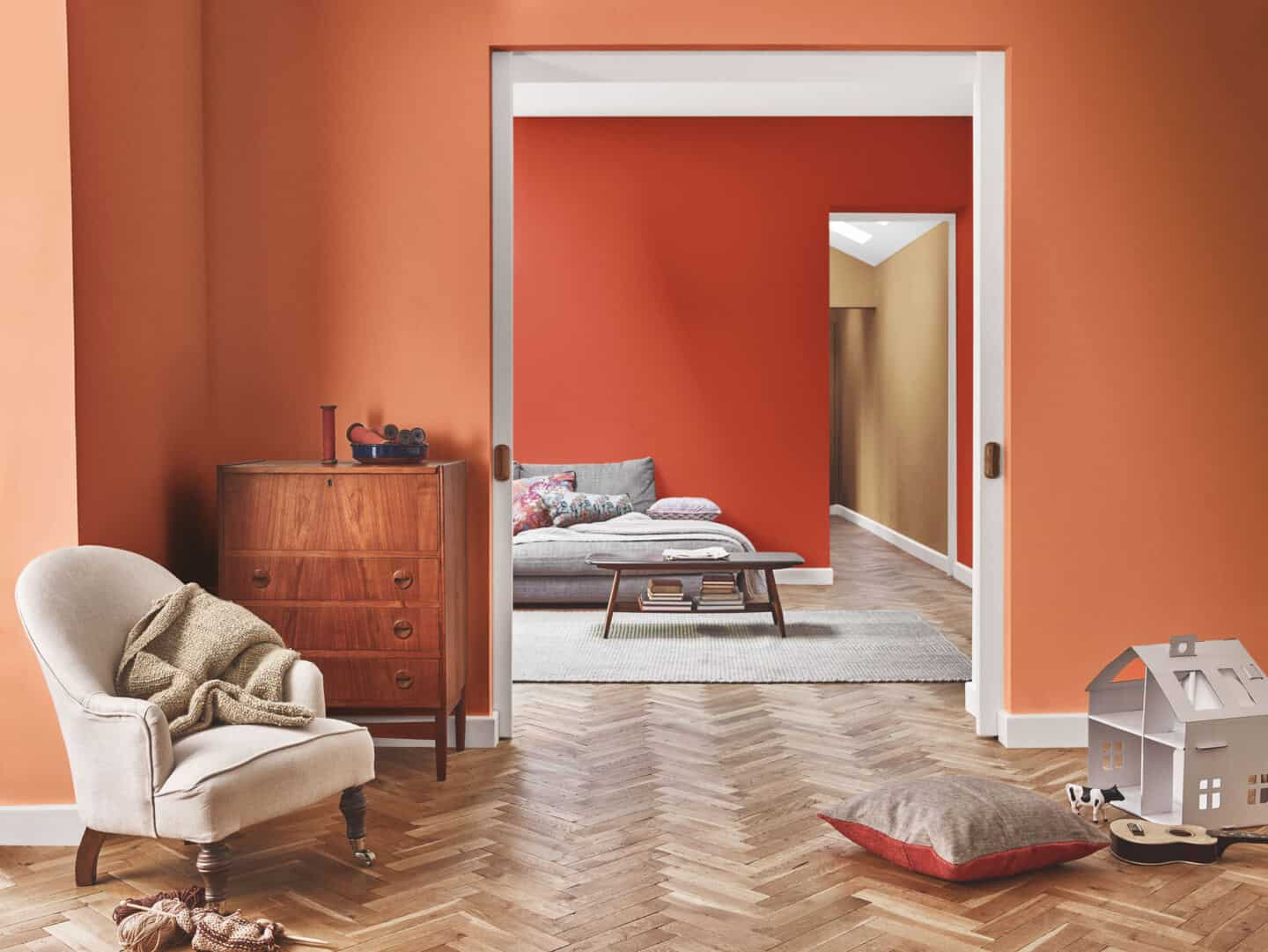 Autumnal Hues in interiors - Dulux colour of th eyear 2019 spiced honey  painted on a wall that is visible through two doorways.