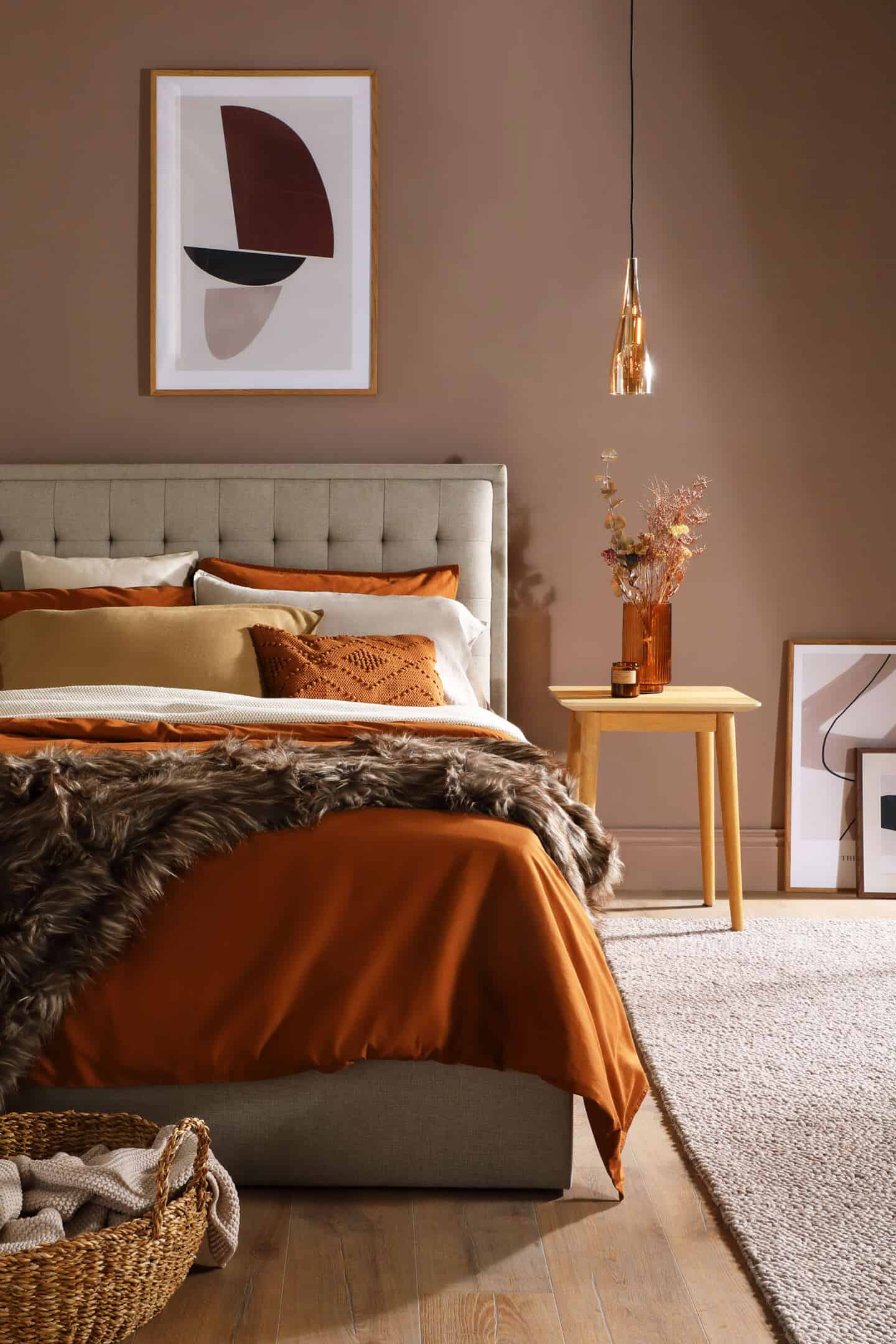 Autumnal Hues in interiors - A beautiful bedroom packed full of bold autumn colours and tactile textures.