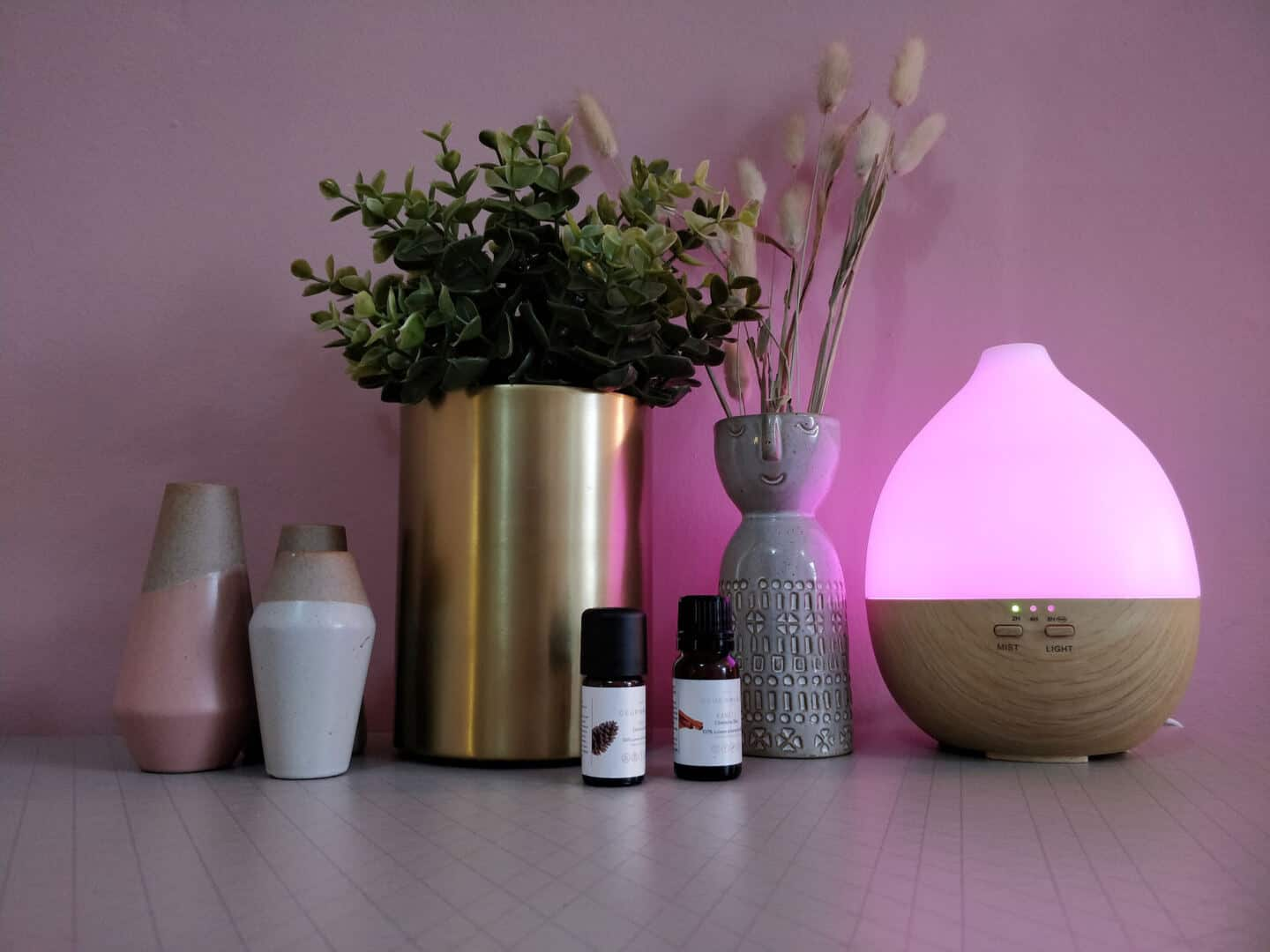 Smellacloud aroma diffuser with the pink LED light illuminated