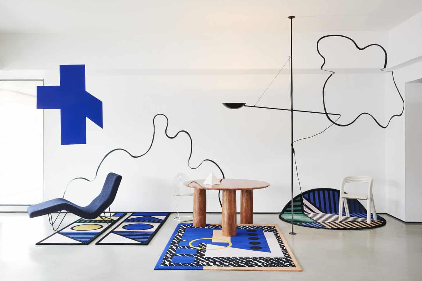 Designer rugs from Floor Story. The Camille Walala collection displayed in a white studio setting.