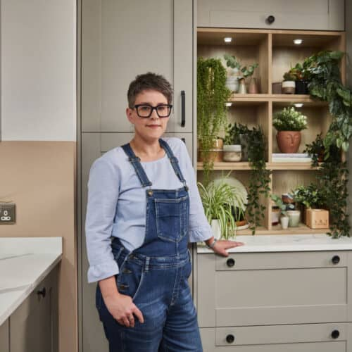 Stacey Sheppard stood in a grey Magnet kitchen