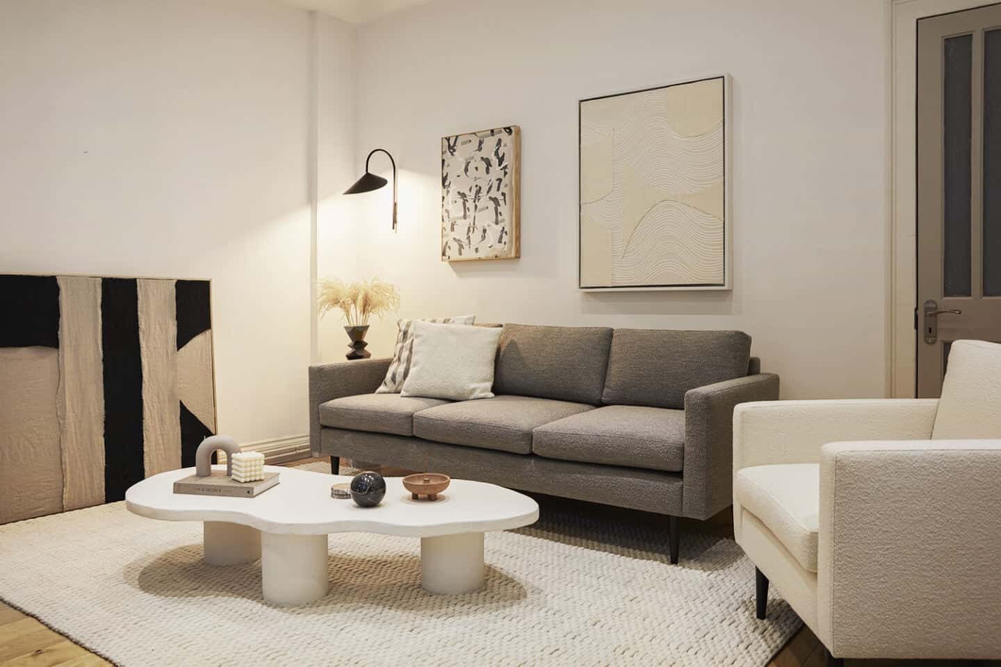 A neutral living room featuring a bouclé sofa collection designed by Interior designer Luke Arthur Wells in collaboration with Swyft Home