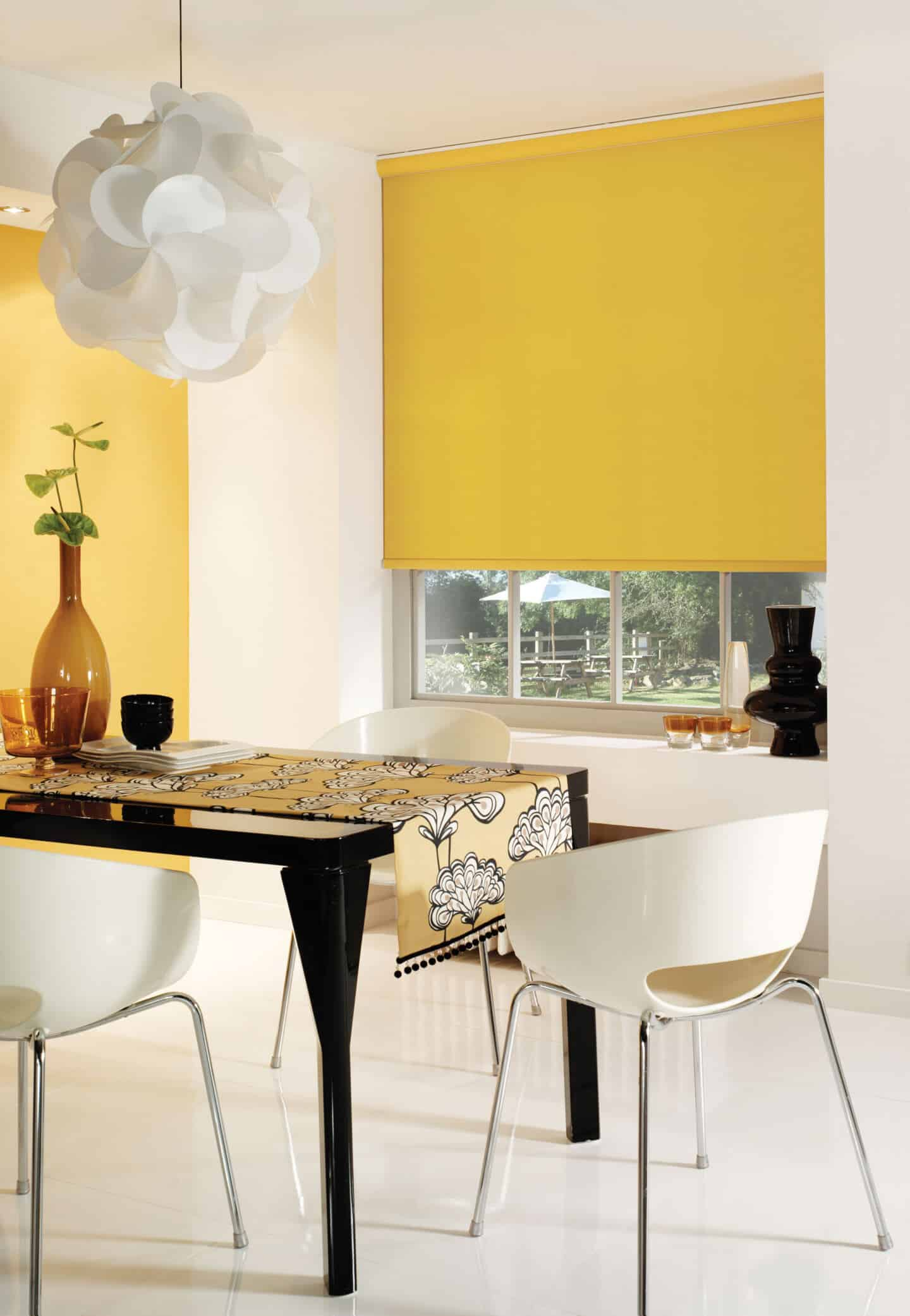 Pantone Colour of the Year 2021 - Illuminating. The colour psychology behind using yellow in interiors. Yellow blinds from English Blinds on a window behind a dining table