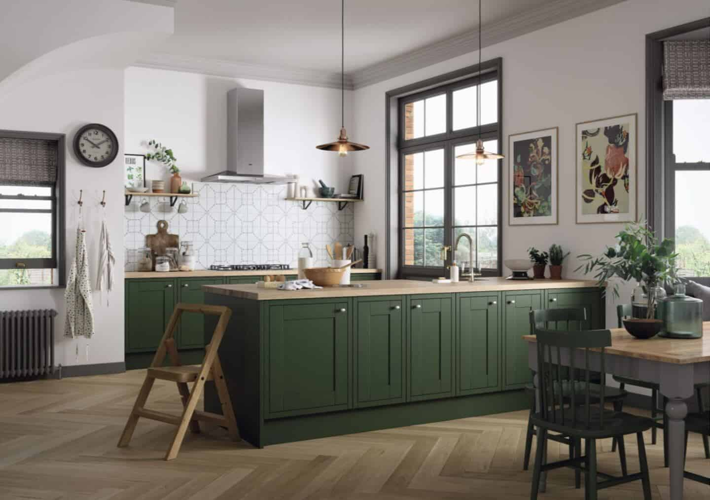 MAgnet's Somerton Kitchen in Forest Walk with a wooden worktop. Natural light floods in fom two large windows.